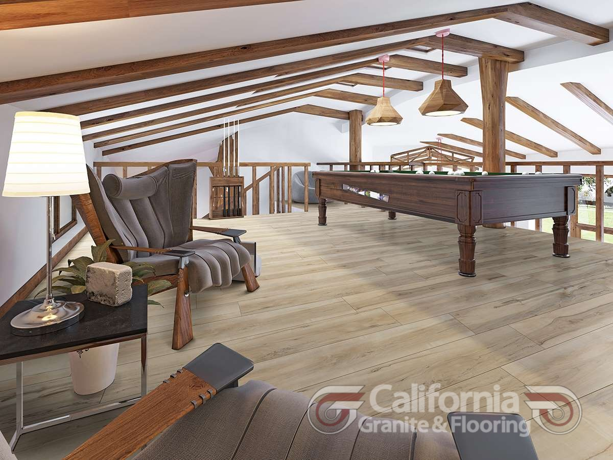 Billiard room in the attic with sitting area and fireplace.